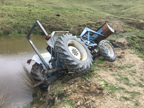 tractor in the pond